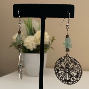 Silver Disc Swirling With Floral Detail